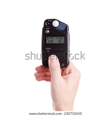 flash meter in hand on white background - stock photo