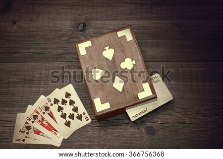 Flash Royal Card Suit And  Playing Card Box On The Grunge Rustic Brown Wood Background Top View - stock photo