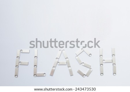 flash written by memory sticks - stock photo