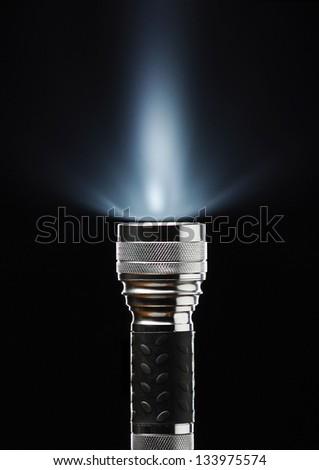 flashlight on black  background - stock photo