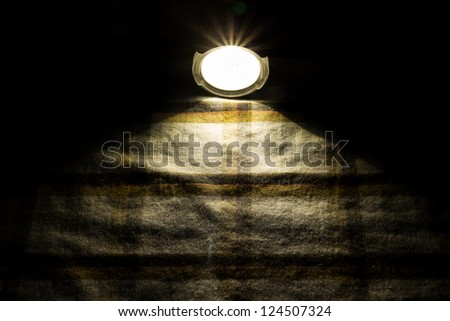flashlight on fabric - stock photo