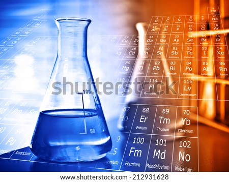 Flask with periodic table of elements - stock photo