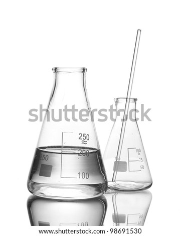 Flask with water and empty flask with reflection isolated on white - stock photo