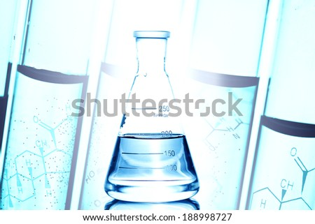 Flask with water and reflection isolated on white