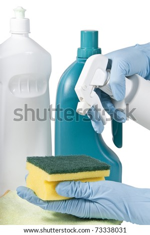 flasks of products of cleaning with hands with gloves and scouring pad - stock photo