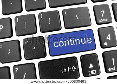 Flat black modern Keyboard of a laptop with Blue Button: continue