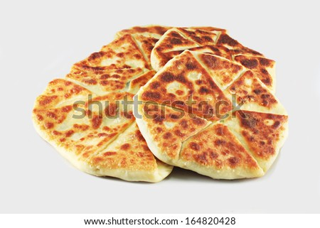 Flat cake with cheese, Khachapuri, flat bread with cheese and herbs - stock photo