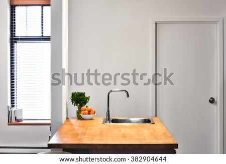 Flat Gray Wall Flat Perspective and a Kitchen Island. - stock photo