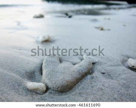 Flat heart-shaped beach stone. Copy space.