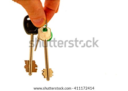 Flat keys in the hand on white background