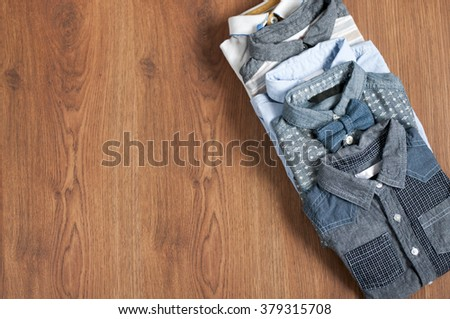 Flat lay children's clothing and accessories on wooden background - stock photo
