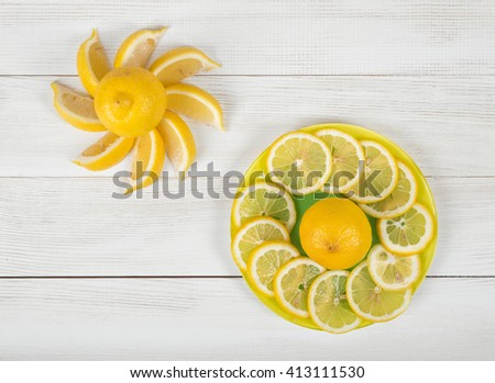 Flat lay of citrus fruit slices laid out on a saucer - stock photo