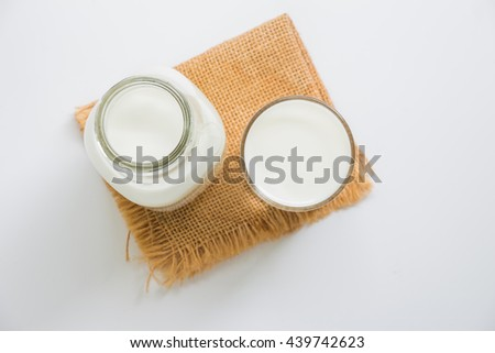 Flat lay of fresh milk on gray background