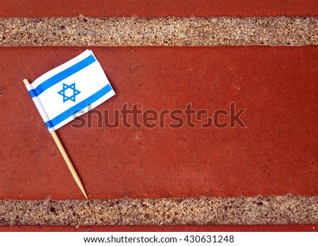 Flat lay of the flag of Israel on a brick surface. Israel indepandace Day background withe copyspace - stock photo