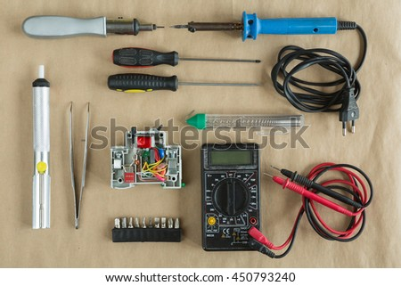 Flat lay of Tools for electrician Repair - multimeter , tweezers, residual current device, soldering iron , solder , bits , differential machine - stock photo