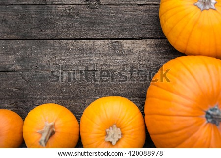 Flat lay, orange Pumpkins on a old wooden Table, copyspace - stock photo