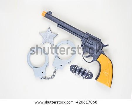 flat lay photo of set toy gun and handcuffs, badge , sheriff . - stock photo