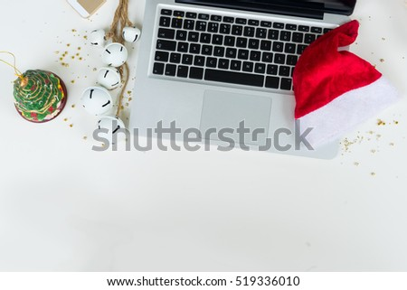 Flat lay scene with office table desk. Workspace with laptop and christmas decorations on white background