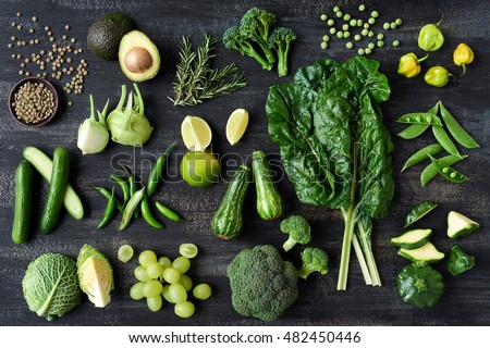 Flat lay series of assorted green toned vegetables, fresh organic raw produce