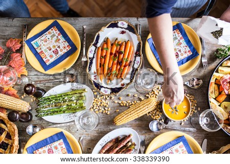Flat lay shot of Lots of traditional festive food on wooden table. Thanksgiving dinner. Depth of field   - stock photo