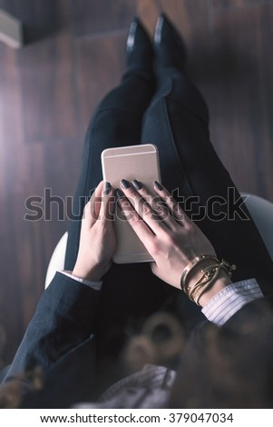 Flat lay shot of Woman accessories. Closeup of stilettos shoes, bracelets and phone.  - stock photo
