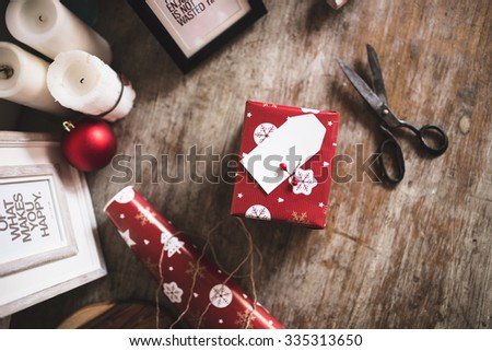 Flat lay shot of Wrapping modern Christmas gifts presents at home