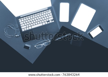 Flat lay x-ray photo of Office table with laptop computer, notebook, digital tablet, mobile phone, Pencil on modern two tone (white and grey) background. Desktop office mockup concept.