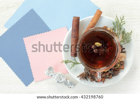 flat layout with tea decorated with different aromatic spices top view / tea flavored with candy - stock photo