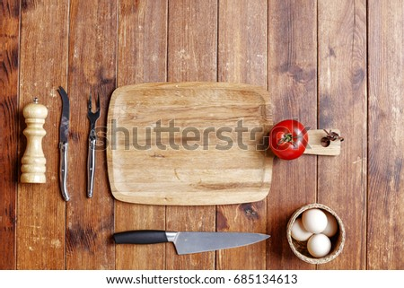flat photo of kitchen tools on brown desk space