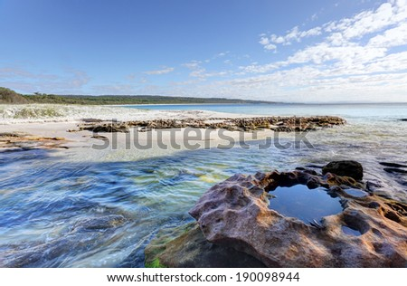 Flat Rock Creek flows into the southern end of Hyams Beach NSW Australia.   - stock photo