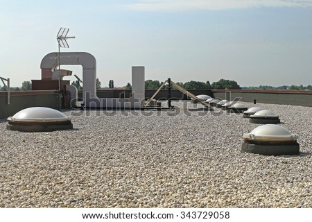 Flat Roof With Gravel and Skylight Windoows - stock photo