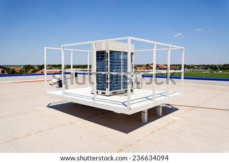 Flat roof with skylight, climatization equipment and hydro insulation membranes - stock photo