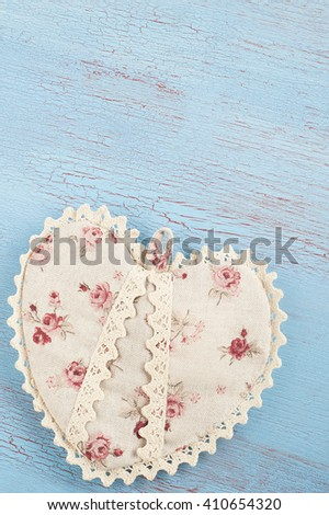 Flat rustic still life, Textile Heart on blue red wooden background in country style for greeting card. - stock photo