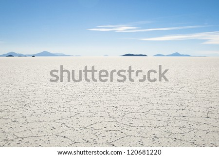 Flat saline desert in Uyuni, Bolivia. - stock photo