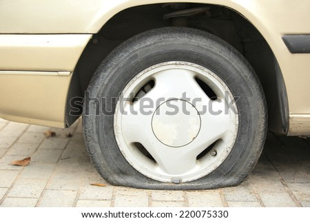 flat tyre on car wheel  - stock photo