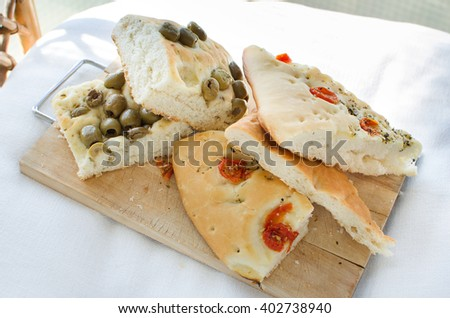 flatbread italy focaccia tomatoes olives flat oven baked Italian genovese ligure - stock photo
