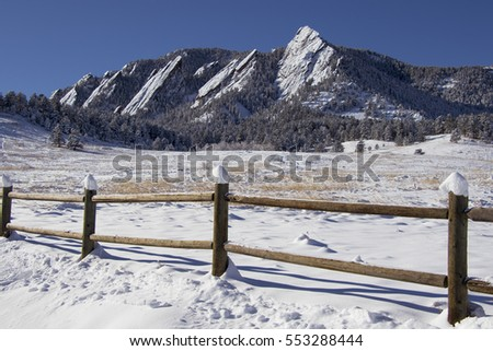 Flatirons rock formations at Chautauqua Park in Boulder, Colorado, morning after a snowstorm.