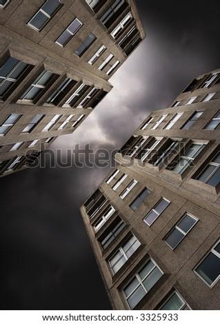 Flats against a dark stormy sky. - stock photo