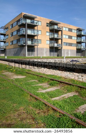 flats or apartments by train track. housing in Rander in Denmark