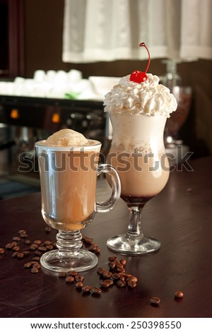Flavored coffee at the bar on the background of cafe - stock photo