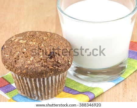 Flax muffin and a glass of milk - stock photo