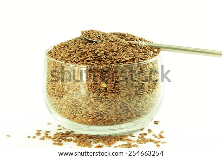 flax seed closeup in pure white background - stock photo