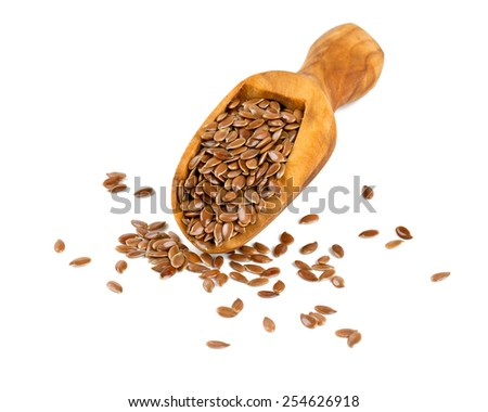 flax seed in a wooden scoop isolated on white - stock photo