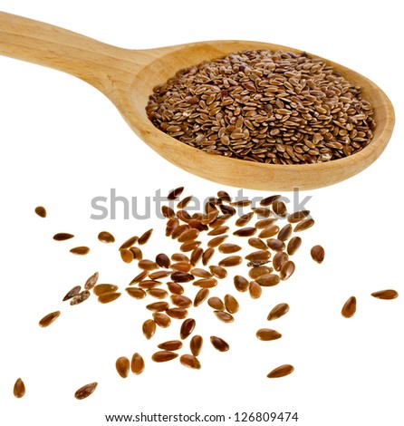 flax seed linseed in wooden spoon closeup isolated on white background - stock photo