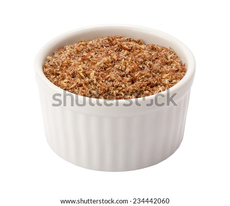Flax Seed Meal in a white Ramekin. The point of view is straight on. The subject is isolated on white and includes a clipping path. - stock photo