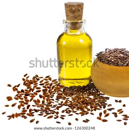 flax seed oil isolated on white background - stock photo