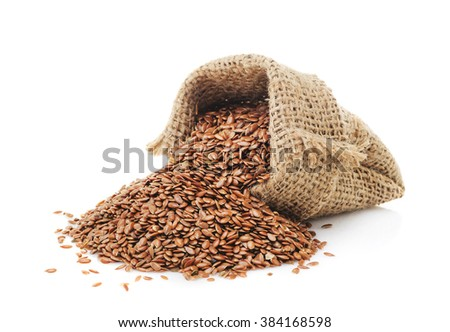 Flax seeds in a bag isolated on a white background closeup - stock photo