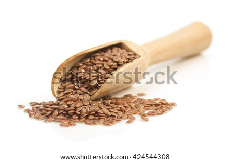 flax seeds in scoop isolated on white background - stock photo
