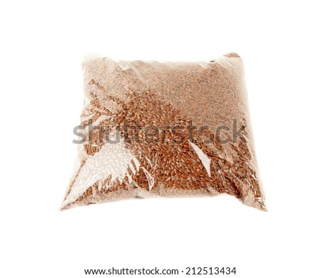 Flax seeds in the package isolated over white background - stock photo