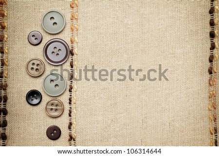 Flax textile texture with buttons - stock photo